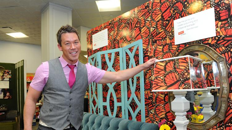 "IMAGE DISTRIBUTED FOR STAPLES - David Bromstad, host of HGTV's ""Color Splash"", was on hand at Staples' Fifth Avenue, New York City location, Tuesday, May 21, 2013, to showcase home and office spaces he designed using the company's new Staples Sports & Art Photo Gallery. Staples is the first to offer a same-day service of new license photo content which includes the NFL and NBA, as well as art, landscapes and more. (Photo by Diane Bondareff/Invision for Staples/AP Images)"