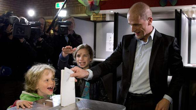 Labour Party PvdA leader Diederik Samsom casts his vote for parliamentary elections as his six-year-old son Benthe, left, and eleven-year-old daughter Fane, center rear, look on at a polling station in Leiden, central Netherlands, Wednesday Sept. 12, 2012. (AP Photo/Peter Dejong)