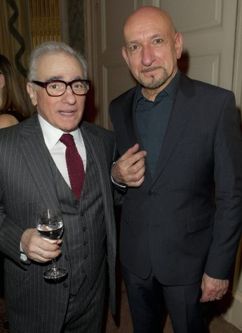LONDON: British actor Sir Ben Kingsley and U.S director Martin Scorsese, left, pose for photographs during pre Bafta drinks reception for Scorsese at Claridges in London, Friday, Feb. 10, 2012. Scorsese receives the Bafta Fellowship award during the ceremony on Sunday. AP/PTI(AP2_11_2012_000047A)