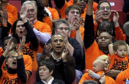 U.S. President Obama attends the game between Princeton and Green Bay for the 2015 Women's NCAA Basketball Tournament at the XFINITY Center in College Park, Maryland