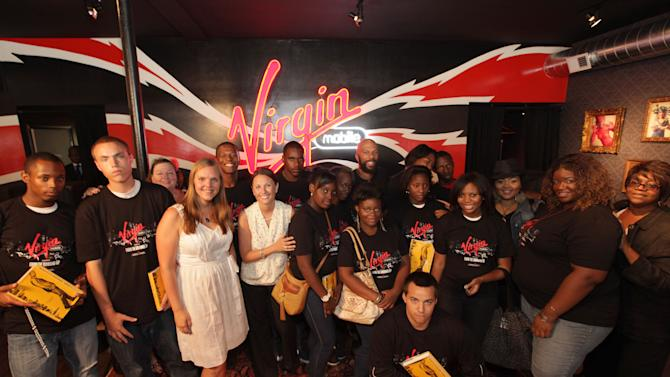 "Common poses with youths, and workers, of the Night Ministry at the Virgin Mobile's ""From The Ground Up"" event on Thursday, July 26, 2012 in Chicago, IL. (Photo by Barry Brecheisen/Invision for Virgin Mobile/AP Images)"
