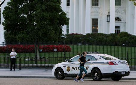 A United States uniformed Secret Service officer is seen at a post in front of the White House in Washington