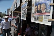 <p>Pedestrians walk past a newsstand in Athens. Greece on Wednesday was close to forming a coalition to revise an unpopular EU-IMF bailout deal and pull the country out of a harrowing recession that has doomed its economic recovery efforts.</p>