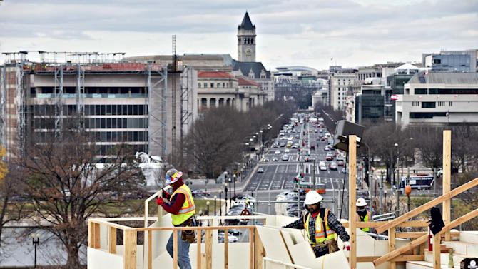With forty days until President Barack Obama is sworn in for a second term, construction continues on the platforms on the west side of the Capitol, looking down Pennsylvania Avenue in Washington, Tuesday, Dec. 11, 2012, where dignitaries and news cameras will witness the inauguration ceremonies, Tuesday, Dec. 11, 2012. The Old Post Office Pavilion is at left.  (AP Photo/J. Scott Applewhite)
