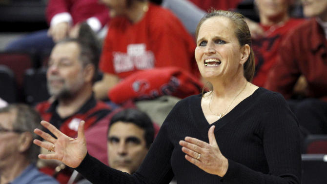 FILE - In this Thursday, Dec. 8, 2011 file photo, Fordham head coach Stephanie Gaitley talks to her players during the second half of an NCAA college basketball game against Rutgers in Piscataway, N.J. It was only a few years ago when Fordham was the laughing stock of women's basketball, setting a record for futility. Now second-year coach Gaitley has the Rams near the top of the Atlantic 10. (AP Photo/Mel Evans, File)