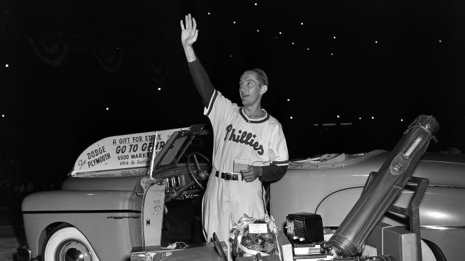 "FILE - In this Aug. 19, 1949 file photo, Philadelphia Phillies first baseman Eddie Waitkus acknowledges the applause of fans at Shibe Park as he stands by gifts showered on him on ""Eddie Waitkus Night"" in Philadelphia. Waitkus was in uniform for the first time since he was shot, June 14, 1949, in a Chicago hotel by 19-year-old Ruth Steinhagen. Steinhagen died of natural causes at 83 in late December 2012. Her death is the final chapter in one of the most sensational and bizarre criminal cases in Chicago history that made headlines around the country. She was the inspiration for Bernard Malamud's novel ""The Natural"" and the 1984 movie starring Robert Redford. (AP Photo/File)"