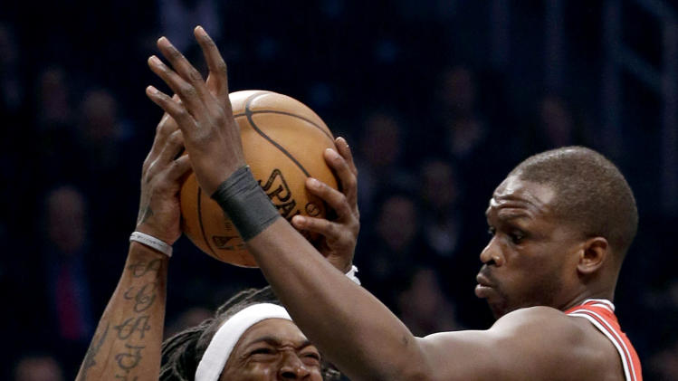 Chicago Bulls forward Luol Deng, right, defends against Brooklyn Nets forward Gerald Wallace (45) in the first half of Game 5 of their first-round NBA basketball playoff series, Monday, April 29, 2013, in New York. (AP Photo/Kathy Willens)
