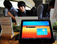 "The Galaxy Tab 10.1 is displayed at the KT Mobile showroom in Seoul on October 13, 2011. Samsung won a patent battle Monday against US rival Apple, with a British judge ruling that Samsung's Galaxy tablet was not ""cool"" enough to be confused with Apple's iPad"