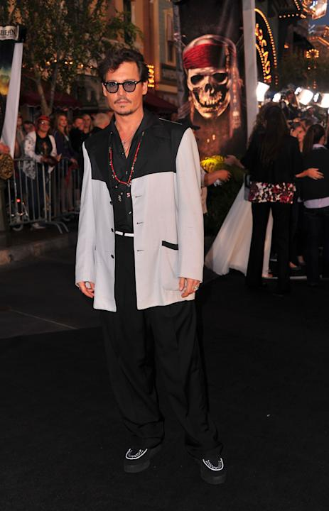 Depp in a cream and black look