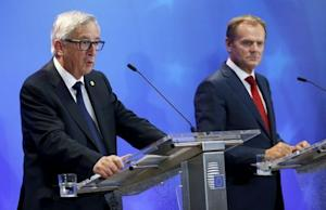 EU Commission President Juncker and EU Council President Tusk address a joint news conference after a EU leaders extraordinary summit on the migrant crisis in Brussels