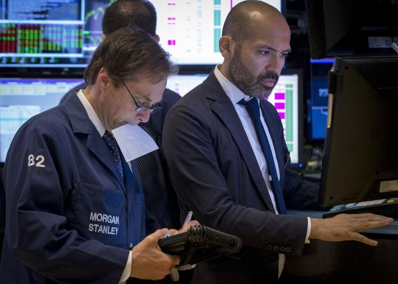 Dow, S&P 500 end slightly lower after Fed minutes