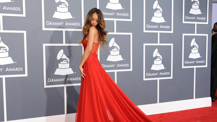 Rihanna arrives at the 55th annual Grammy Awards on Sunday, Feb. 10, 2013, in Los Angeles.  (Photo by Jordan Strauss/Invision/AP)