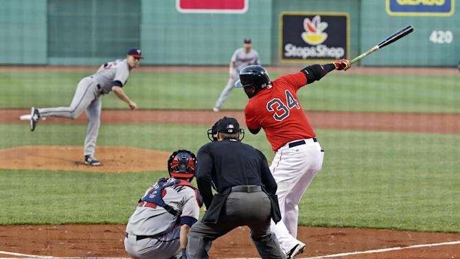 Boston Red Sox's David Ortiz swings at a pitch delivered by Minnesota Twins starting pitcher Trevor May in the first inning of a baseball game at Fenway Park in Boston, Wednesday, June 3, 2015. (AP Photo/Elise Amendola)