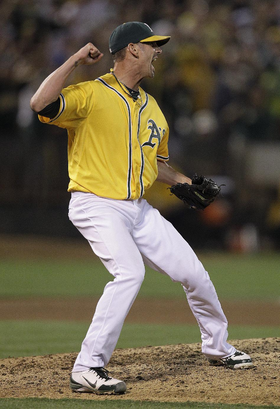 Oakland Athletics' Grant Balfour reacts as the final out is made against the Texas Rangers at the end of a baseball game Tuesday, Oct. 2, 2012, in Oakland, Calif. The A's won 3-1.(AP Photo/Ben Margot)