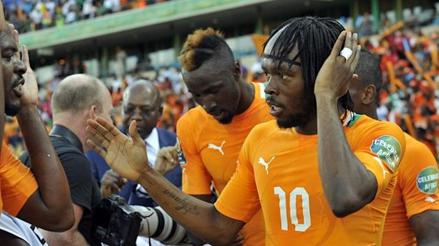 Ivory Coast forward Gervinho (R) celebrates with teammates after scoring a goal against Tunisia during the 2013 African Cup of Nations match at Royal Bafokeng Stadium in Rustenburg