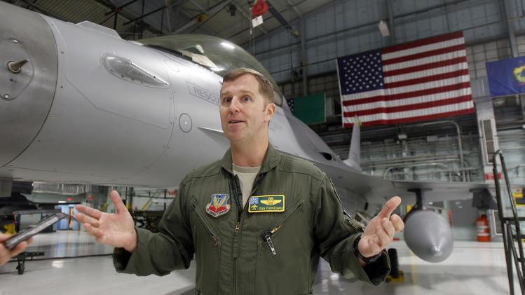 In this Monday, Dec. 17, 2012 photo, Lt. Col. Dan Finnegan stands by an F-16 fighter plane as he's interviewed in South Burlington, Vt. To people hoping the Air Force will choose Vermont as home to at least 18 F-35 fighter planes, the next-generation aircraft is a source of hundreds of jobs, millions of dollars for the local economy and incalculable state pride. To opponents, the plane is a looming nuisance so much louder than its predecessor, the F-16, it will make life unbearable for people beneath its flight path. The Air Force is nearing its decision about where it will base the planes. (AP Photo/Toby Talbot)