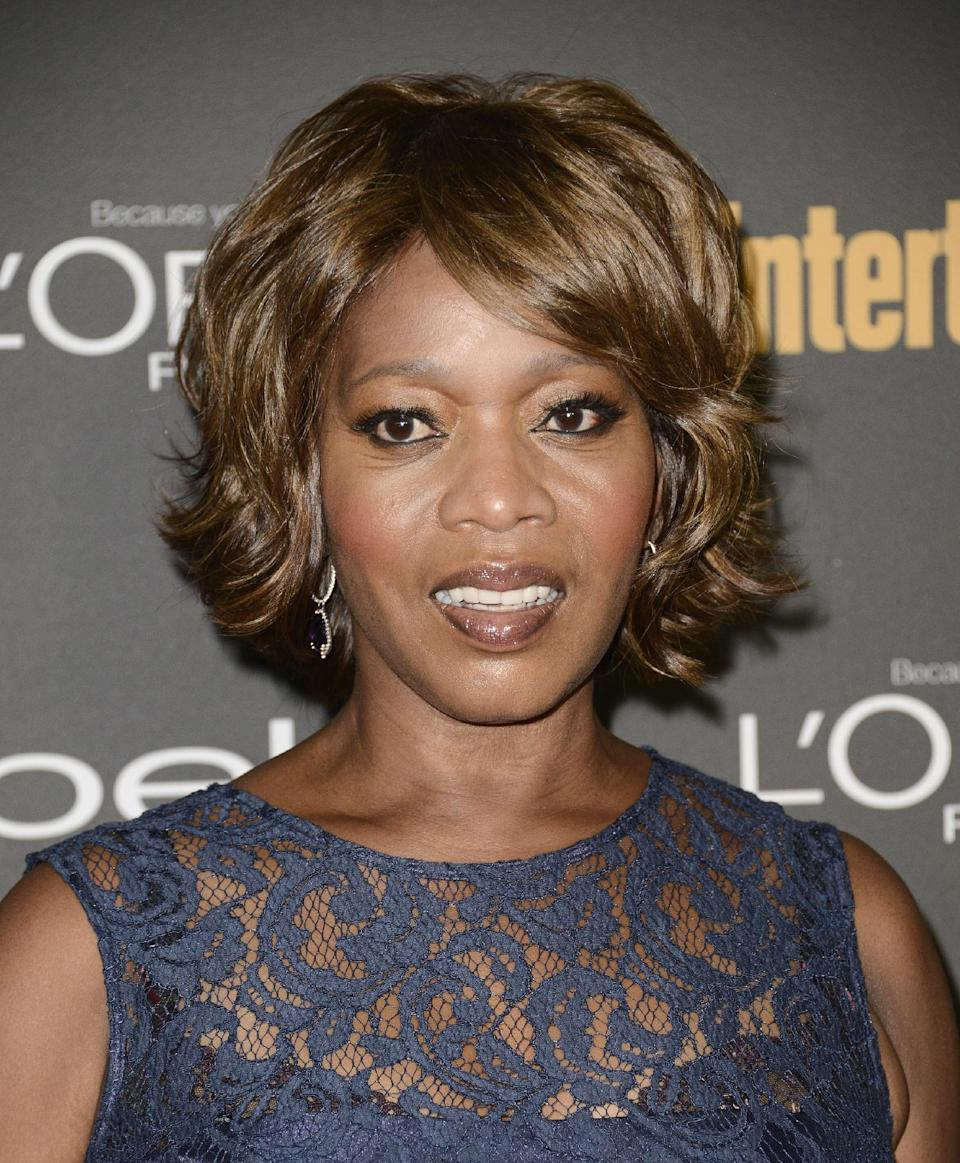 Actress and Emmy nominee Alfre Woodard arrives at the 2013 Entertainment Weekly Pre-Emmy Party at Fig & Olive on Friday, Sept. 20, 2013 in Los Angeles. (Photo by Dan Steinberg/Invision/AP)