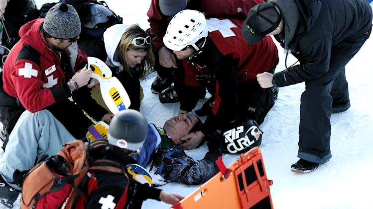 Simon d'Artois, of Canada, is aided by emergency personnel after he crash during the halfpipe freestyle skiing competition at the U.S. Grand Park, Saturday, Feb. 2, 2013, in Park City, Utah (AP Photo/George Frey)