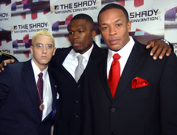 "FILE - Rappers Eminem, left, 50 Cent, center, and Dr. Dre pose for photographers after arriving at the Roseland Ballroom for a concert ""The Shady National Convention,"" in this Oct. 28, 2004 file photo taken in New York. The rumors were true: Eminem joined 50 Cent to recreate ""Get Rich or Die Tryin'"" at South By Southwest Friday March 16, 2012. While Dr. Dre didn't show, Eminem joined 50 on ""Patiently Waiting"" and a short encore that almost didn't come off because of lackluster crowd reaction. (AP Photo/Ramin Talaie)"