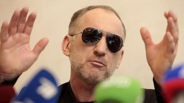 The father of the two Boston bombing suspects, Anzor Tsarnaev speaks at a news conference in Makhachkala, the southern Russian province of Dagestan, Thursday, April 25, 2013. The father of the two Boston bombing suspects said Thursday that he is leaving Russia for the United States in the next day or two, but their mother said she was still thinking it over. (AP Photo/Musa Sadulayev)