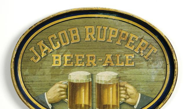 """This undated photo provided by the New-York Historical Society shows a metal """"Jacob Ruppert Beer-Ale,"""" bar tray dated 1900-1930, which will be a part of the uncoming exhibit """"Beer Here,""""  which will feature a small beer hall and the chance to try a selection of New York City and state artisanal beers. (AP Photo/ New-York Historical Society)"""