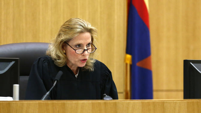 Judge Sherry Stephens denies the request from Jodi Arias' defense attorneys Jennifer Wilmott and Kirk Nurmi to withdraw from the case on Monday, May 20, 2013 during the penalty phase of Arias' murder trial at Maricopa County Superior Court in Phoenix, Ariz. Arias was convicted May 8, 2013 of first-degree murder in the stabbing and shooting to death of Travis Alexander, 30, in his suburban Phoenix home in June 2008. (AP Photo/The Arizona Republic, Rob Schumacher, Pool)
