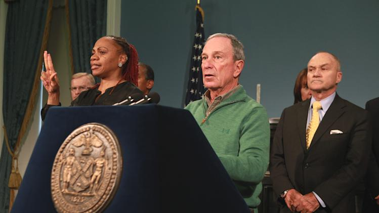 In this photo provided by New York City Mayor's Office, New York City Mayor Michael Bloomberg updates the media on the City's Superstorm Sandy recovery efforts, Friday, Nov. 2, 2012 in New York. Later that day Bloomberg Bloomberg cancelled the 2012 New York Marathon amid growing public pressure. Behind Bloomberg is NYC Police Commissioner Raymond Kelly. (AP Photo/NYC Mayor's Office, Kristin Artz)