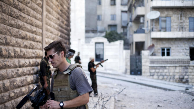 This photo posted on the website freejamesfoley.org shows journalist James Foley in Aleppo, Syria, in September, 2012. The family of an American journalist says he went missing in Syria more than one month ago while covering the civil war there. A statement released online Wednesday by the family of James Foley said he was kidnapped in northwest Syria by unknown gunmen on Thanksgiving day. (AP Photo/Manu Brabo, freejamesfoley.org) NO SALES