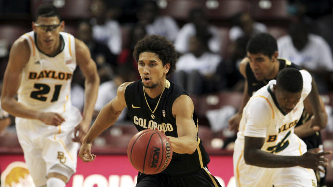 Colorado's Askia Booker, center, dribbles the ball upcourt against Baylor during the second half of an NCAA college basketball game at the Charleston Classic at TD Arena, Friday Nov. 16, 2012, in Charleston, S.C. Colorado won 60-58. (AP Photo/Alice Keeney)