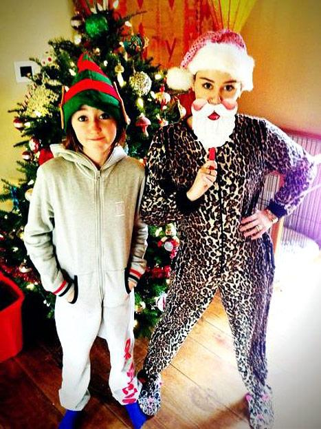Miley Cyrus Wears Leopard-Print Onesie Pajamas, Santa Beard on Christmas Day: Picture
