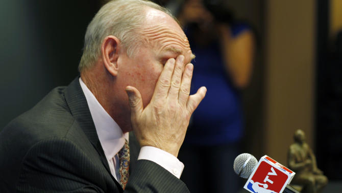 Denver Nuggets head coach George Karl fights back tears as he speaks during a news conference where he was named the NBA Coach of the Year, Wednesday, May 8, 2013, in Denver. (AP Photo/David Zalubowski)