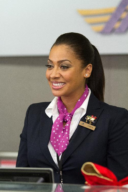 "This film image released by Fox Searchlight shows LaLa Anthony in a scene from ""Baggage Claim."" (AP Photo/Fox Searchlight, Tony Rivetti)"