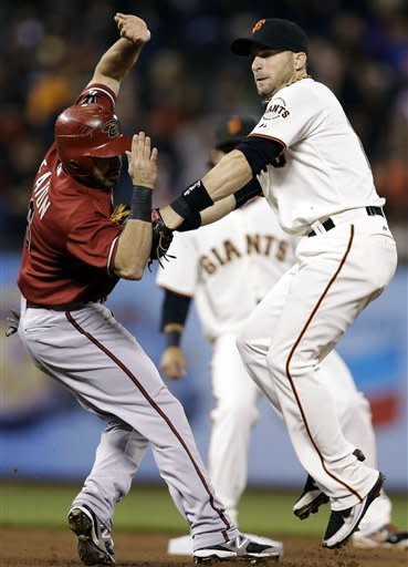 Cain pitches, hits Giants past Diamondbacks, 6-0