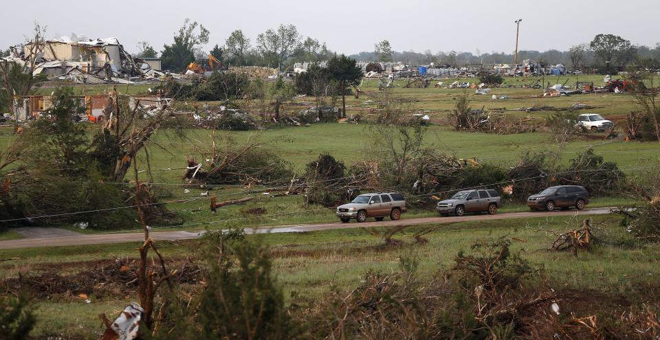Damaged homes are seen in Carney, Okla., Sunday, May 19, 2013, after a tornado moved through the area. (AP Photo/The Oklahoman, Bryan Terry)