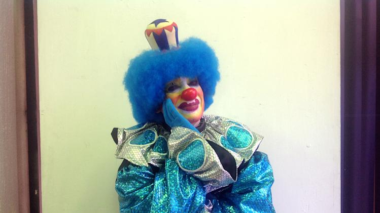 In this Tuesday, Oct. 23, 2012 photo, grostesque whiteface clown,  Llantom, 60, poses for a photo during Mexico's 17th annual clown convention, La Feria de la Risa, in Mexico City.  Approximately 500 clowns gathered at two local theaters in the capital city to exchange ideas, compete for laughs and show off their comedy performances. Llantom is the fair's principal event organizer and has been in the clown business for 19 years.  (AP Photo/Anita Baca)
