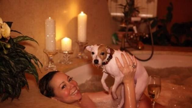 Mariah Carey is seen in her bathtub with her dog Jill E Beans seen taking a bath on February 14, 2013 -- Twitter