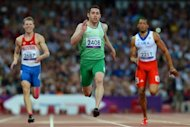 Ireland&#39;s Jason Smyth (C) crosses the line to win gold ahead of Russia&#39;s Alexander Zverev (L) and Cuba&#39;s Luis Felipe Gutierrez (R) in the men&#39;s 200m - T13 final during the athletics competition at the London 2012 Paralympic Games on September 7, 2012