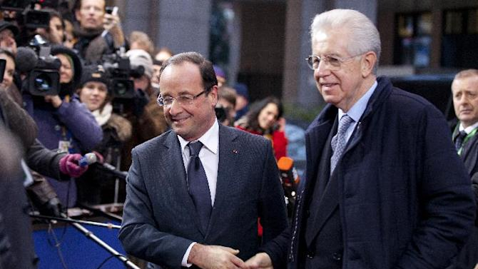 French President Francois Hollande, center left, shakes hands with Italian Prime Minister Mario Monti as they arrive for an EU summit in Brussels on Thursday, Dec. 13, 2012. In one whirlwind morning, the European Union nations agreed on the foundation of a fully-fledged banking union and Greece's euro partners approved billions of euros in bailout loans that will prevent the nation from going bankrupt. (AP Photo/Virginia Mayo)