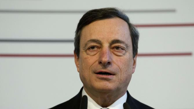 Mario Draghi, President of the European Central Bank, delivers his speech on the annual reception of German private banks in Berlin, Monday, March 26, 2012. (AP Photo/Markus Schreiber)