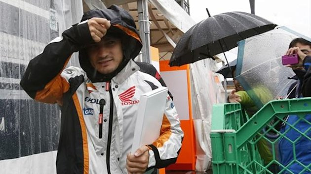 Honda MotoGP rider Dani Pedrosa of Spain walks in the paddock area ahead of Sunday's Japanese Grand Prix in Motegi (Reuters)