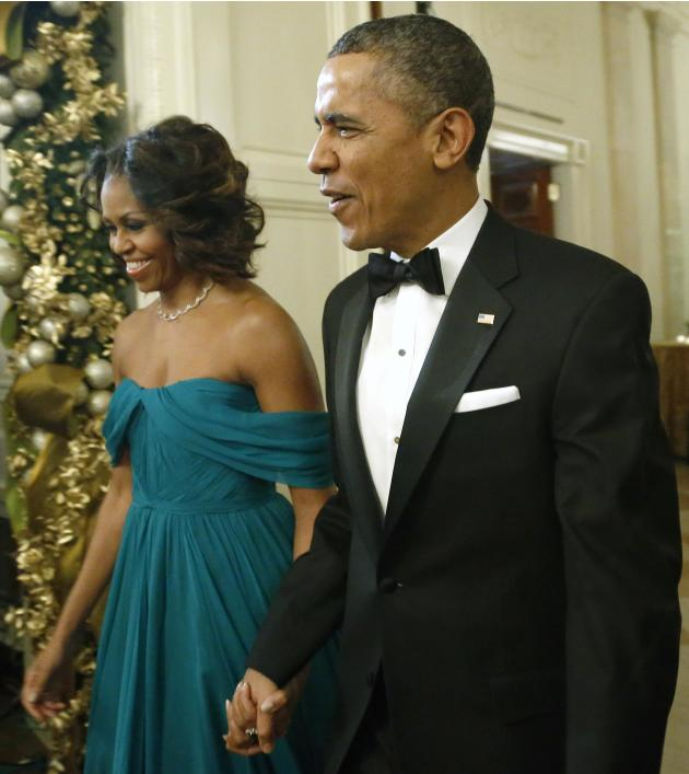 U.S. President Barack Obama and first lady Michelle Obama arrive for a reception for the 2013 Kennedy Center Honors recipients at the White House in Washington