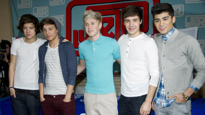 """FILE - In this March 12, 2012 file photo, One Direction band members Harry Styles, from left, Louis Tomlinson, Niall Horan, Liam Payne and Zayn Malik attend a CD signing at J&R Music World in New York. One Direction's debut album """"Up All Night""""  entered the US Billboard 200 chart at #1 with over 176,000 copies sold.  (AP Photo/Charles Sykes, file)"""