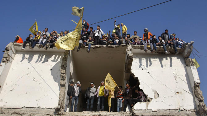 Palestinians hold Fatah yellow flags during celebrations marking the 48th anniversary of the Fatah movement in Gaza City, Friday, Jan. 4, 2013. The secular-leaning Fatah party staged a massive rally Friday in the Gaza Strip, the first such gathering in the territory since the Islamist Hamas group violently took control there in 2007 - a reflection of the warming ties between the two rival Palestinian factions.(AP Photo/Hatem Moussa)