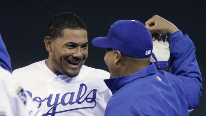 Kansas City Royals' Melky Cabrera (53) and Brayan Pena celebrate after Cabrera's game-winning RBI single in the 12th inning of a baseball game against the Chicago White Sox, Tuesday, April 5, 2011, in Kansas City, Mo. Chris Getz scored on the hit, giving the Royals a 7-6 win. (AP Photo/Ed Zurga)