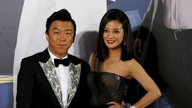 Chinese actor Huang Bo and actress Zhao Wei pose on the red carpet upon their arrival at Hong Kong Film Awards