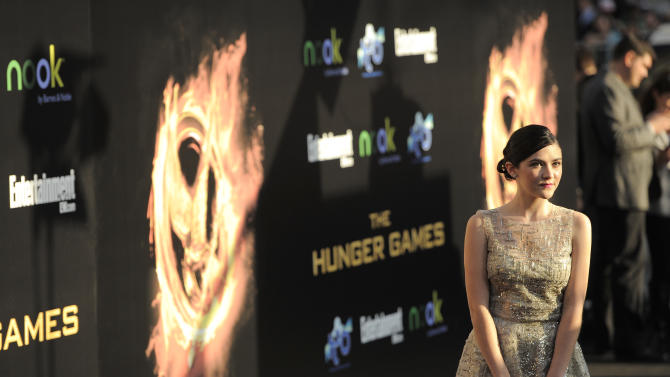 "Actress Isabelle Fuhrman arrives at the world premiere of ""The Hunger Games"" on Monday, March 12, 2012 in Los Angeles. (AP Photo/Chris Pizzello)"