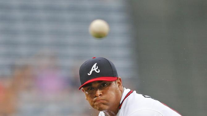 Atlanta Braves starting pitcher Manny Banuelos delivers a pitch in the first inning of a baseball game against the Washington Nationals on Thursday, July 2, 2015, in Atlanta. Banuelos was making his major league debut.  (AP Photo/John Bazemore)