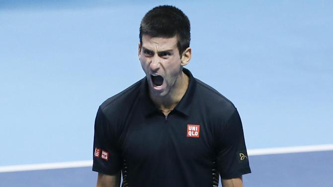 Novak Djokovic of Serbia reacts after winning match point to defeat Roger Federer of Switzerland in their ATP World Tour Tennis singles final match in London, Monday, Nov.  12, 2012. (AP Photo/Kirsty Wigglesworth)