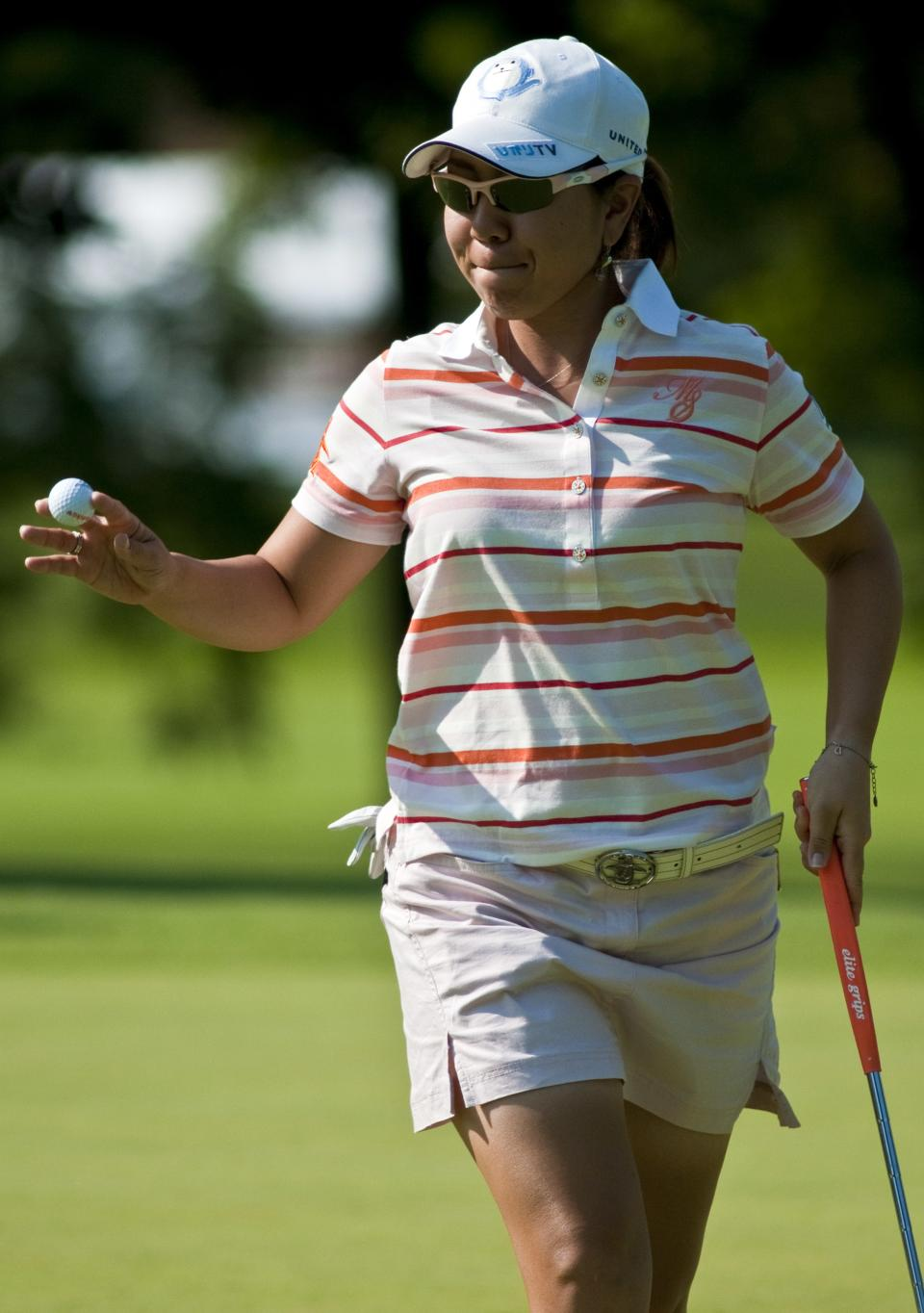 Mika Miyazato of Japan, gestures toward the crowd after sinking a putt for par on the ninth green during the second round of the LPGA NW Arkansas Championship golf tournament in Rogers, Ark., Saturday, June 30, 2012. (AP Photo/April L. Brown)
