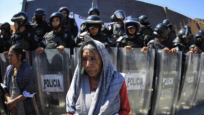 Indigenous women take part in a protest outside the government palace of Guerrero state in Chilpancingo